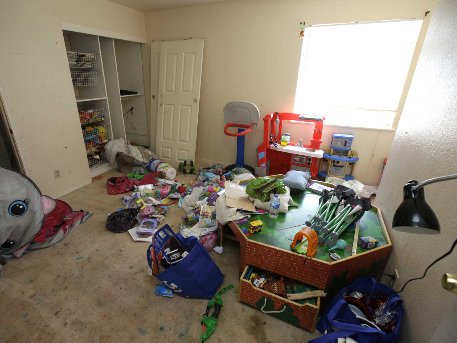 California prosecutors allege 10 children in filthy home were waterboarded, hit with crossbows, BBs, kicked and punched.
